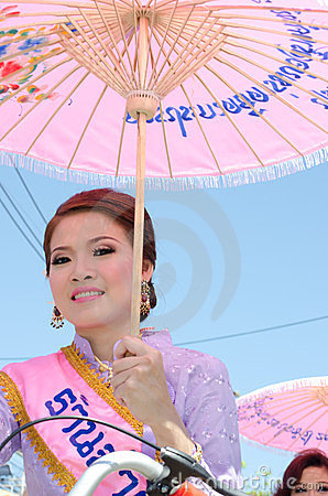 Thai Lady smile in parade of pedal a bicycle. Editorial Stock Image