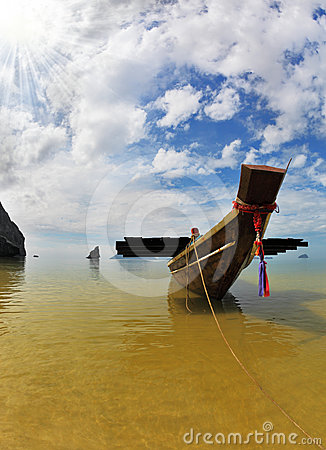 The Thai Longtail boat mooring anchor in the sand