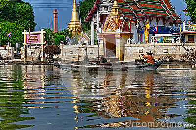 Thai man in longboat Editorial Image