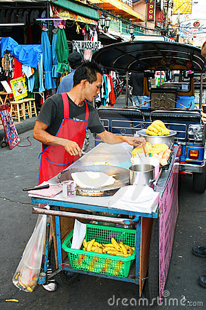 Thai man sells food in Bangkok, Thailand. Editorial Stock Image