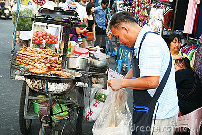 Thai man sells thai food, Bangkok, Thailand. Editorial Stock Image