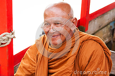 Thai monk in traditional orange clothes Editorial Image