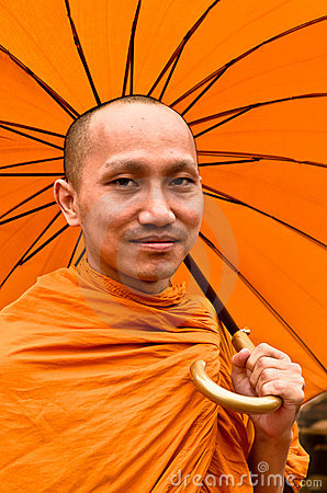 Thai Monk With Umbrella Editorial Image