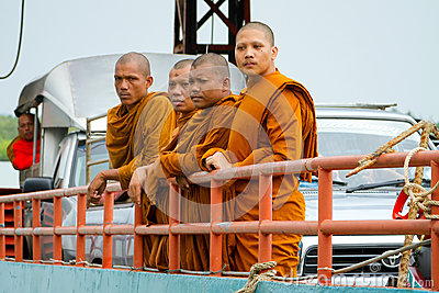 Thai monks in traditional orange clothes Editorial Image