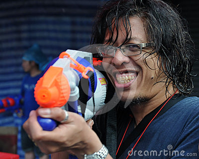 Thai New Year Reveller Enjoys a Water Fight Editorial Stock Photo