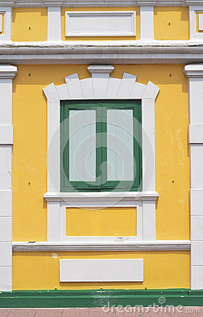 Thai old style classic window in yellow and green