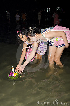 Thai people float on water a small rafts (Krathong Editorial Stock Photo