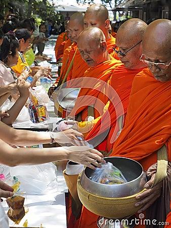 Thai people offer food to monks on Visakha Bucha, Thailand