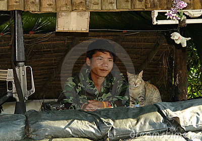 Thai Soldier and Cat Guarding Together at Roadbloc Editorial Photo
