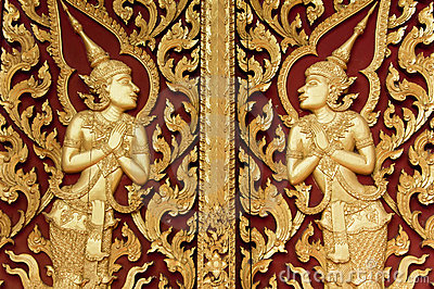 Thai style golden deva carving on wood