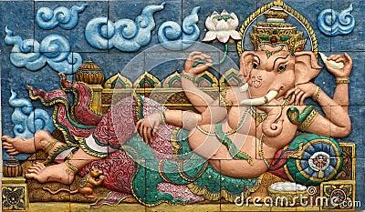 Thai style handcraft of ganesh hindu god on wall