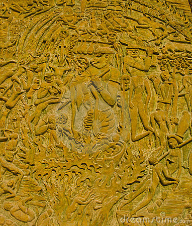 Thai style moral carve on the stone wall.