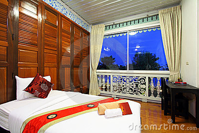 Thai style tropical hotel bedroom Editorial Image