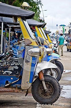 Thai Tuk tuk taxis waiting for hire