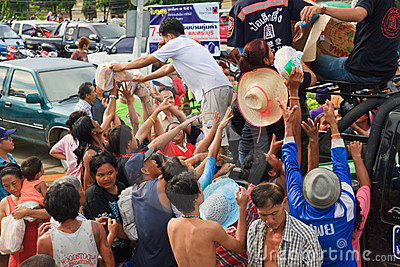 Thai volunteer giving some food bread and water Editorial Stock Image