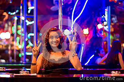 Thai woman on the bar in the nightclub of Patong Editorial Stock Image