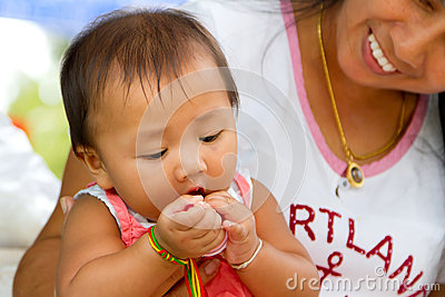 Thai woman with cute baby Editorial Stock Image