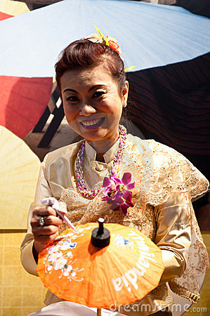 Thai woman paints on umbrellas at BIT 2012 Editorial Photography