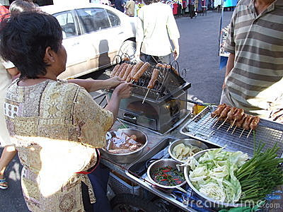 Thai woman selling cooked sausages, Thailand. Editorial Photo