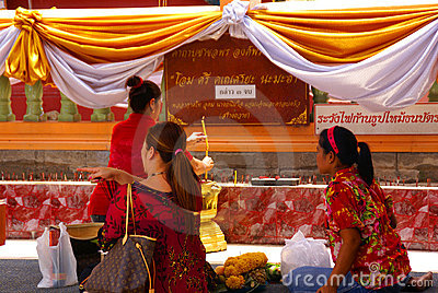 Thai women worship a Buddhist shrine. Editorial Stock Photo
