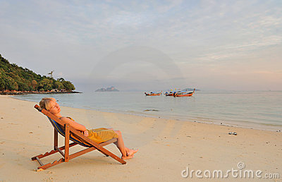 Thailand.Beautiful girl relaxing on deserted beach