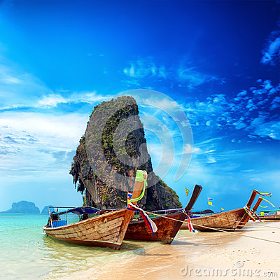 Thailand exotic sand beach and boats in asian tropical island