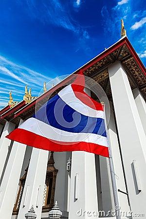 Thailand flag and Buddhist temple