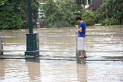 Thailand monsoon , Man on flood Editorial Photo