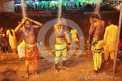 Thaipusam devotee cleansing themselve Editorial Image