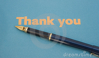 Thank you note on blue paper with pen.