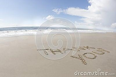 Thank you written on a beach