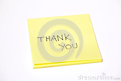 Thank you written on a post-it or a sticky note, isolated on white