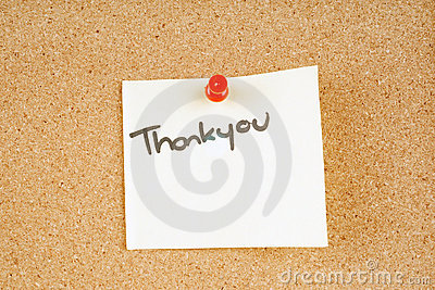 Thankyou note pinned to a corkboard