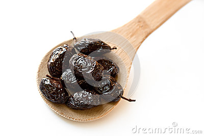 Thassos Throuba Olives in wooden spoon