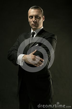 Free The Attractive Man In Black Suit On Dark Background Stock Photo - 101037910