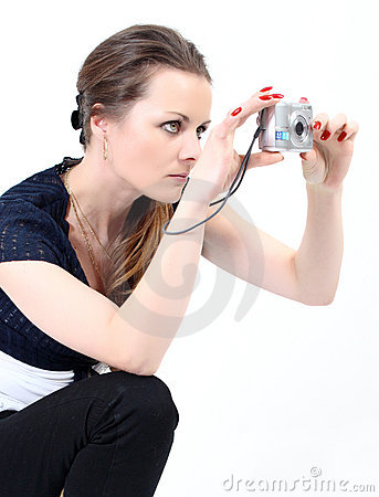 Free The Attractive Woman With Digital Camera Royalty Free Stock Photo - 13977525