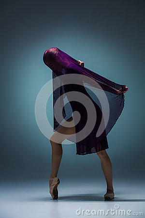 Free The Beautiful Ballerina Dancing With Blue Veil Royalty Free Stock Photography - 65726797