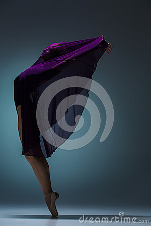 Free The Beautiful Ballerina Dancing With Blue Veil Royalty Free Stock Image - 65727346