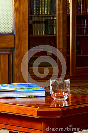 Free The Book And A Glass On The Coffee Table Royalty Free Stock Photo - 30920635