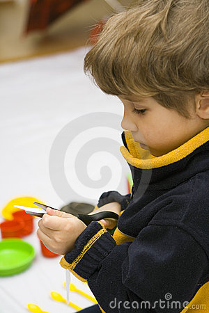Free The Boy And Scissors Royalty Free Stock Image - 8518266