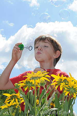 Free The Boy And Soap Bubbles Stock Photography - 5621422