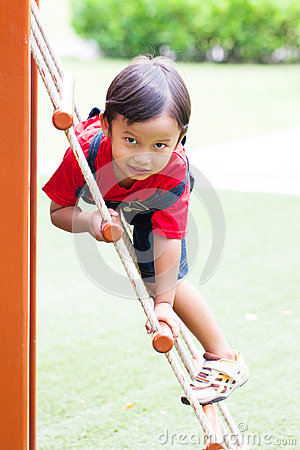 Free The Boy Climbing The Net Royalty Free Stock Photo - 45050905