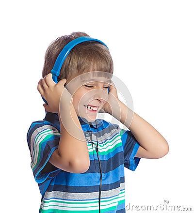 Free The Boy Listens To Music On Headphones. Stock Photos - 26011413