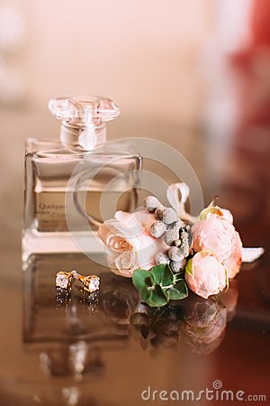 Free The Composition Of The Parfum, Golden Earrings And Lovely Boutonniere Of Pink Roses. Stock Image - 100836141