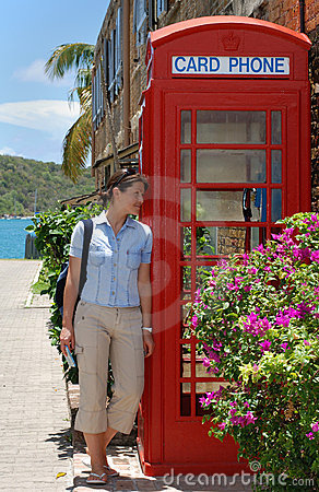Free The Girl By The Phone Booth Royalty Free Stock Image - 4357386