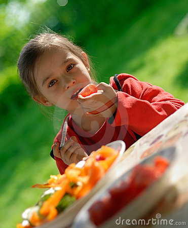 Free The Girl Eats A Tomato Stock Photo - 5291820