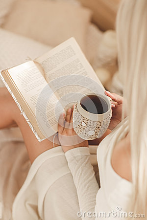 Free The Girl Is Drinking Coffee And Reading A Book Stock Image - 46718821
