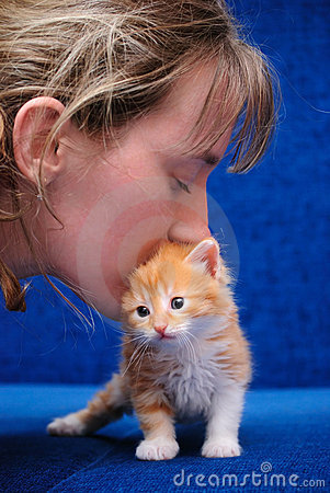 Free The Girl Kisses A Red Kitten Royalty Free Stock Photo - 14256385