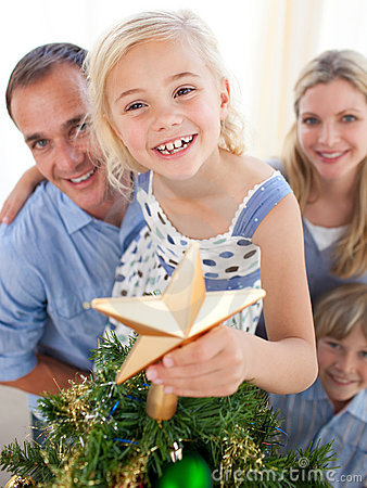 Free The Girl Put The Christmas Star On Top The Tree Royalty Free Stock Image - 11943506