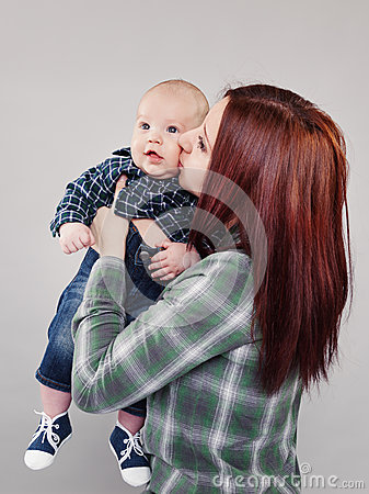 Free The Girl The Teenager Kisses The Baby Stock Images - 30358094